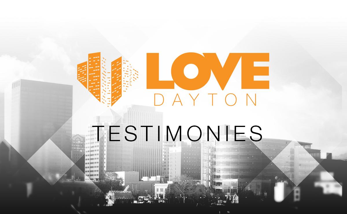 Graphic showing cityscape of Dayton, Ohio. Over photo is Love Dayton logo and text: TESTIMONIES