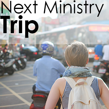 Photograph of a person walking the streets of a foreign nation. Text on image: Next Ministry Trip